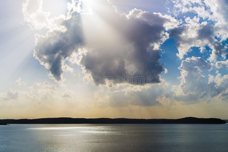 Sunrise / Sunset Light Rays Over Lake stock images