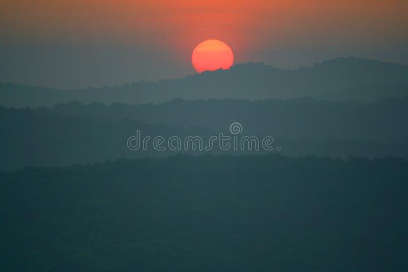 Sunrise / Sunset among the mountains stock photography