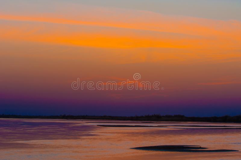 Sunrise sunset. Sunrise over the river. golden waves in the rays of the rising sun stock photo