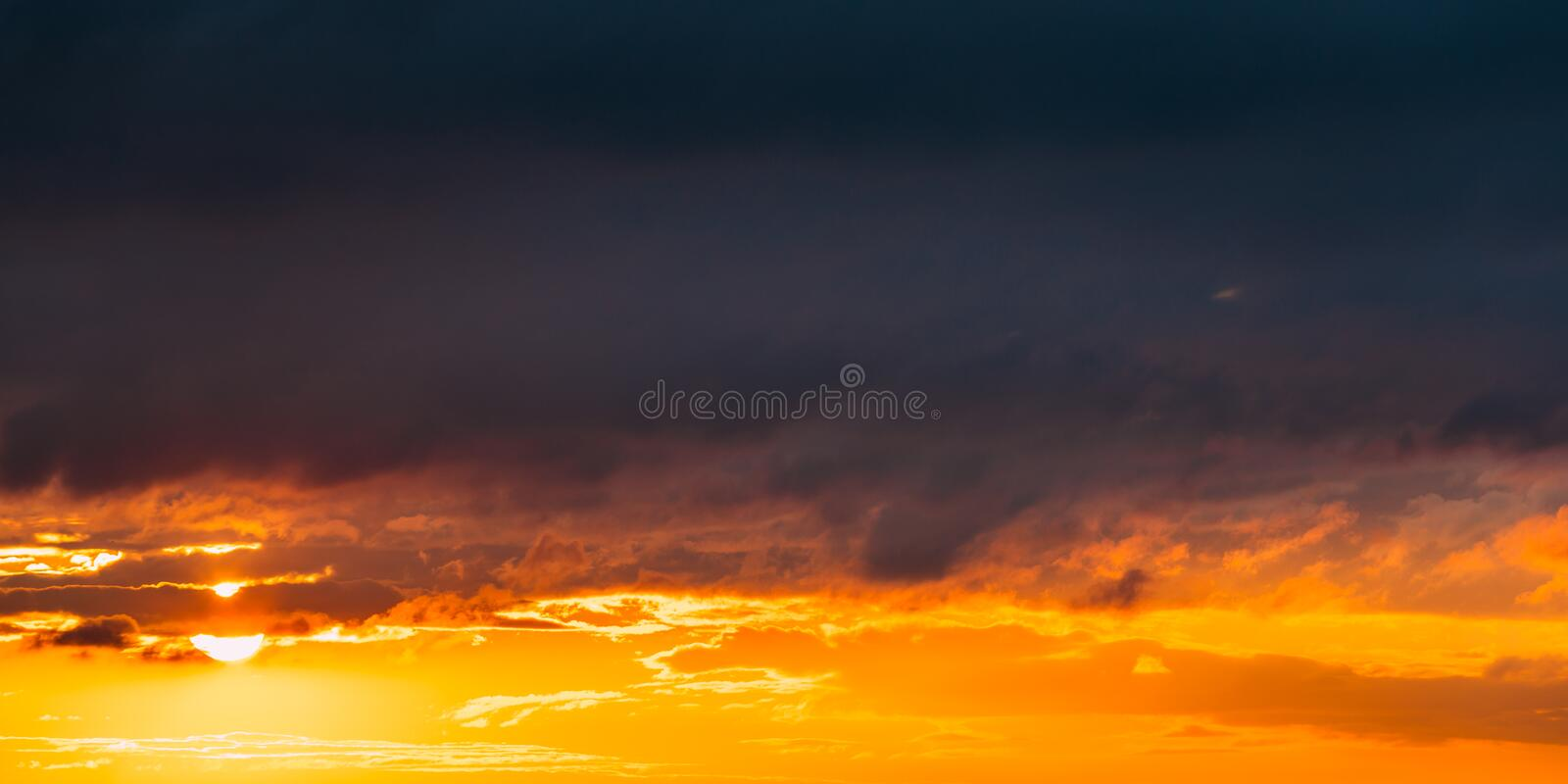 Sunrise Sunset Sunrise Sky. Bright Dramatic Sky With Clouds. Yellow. Orange, Blue And Magenta Colours. Panorama, Panoramic View royalty free stock image