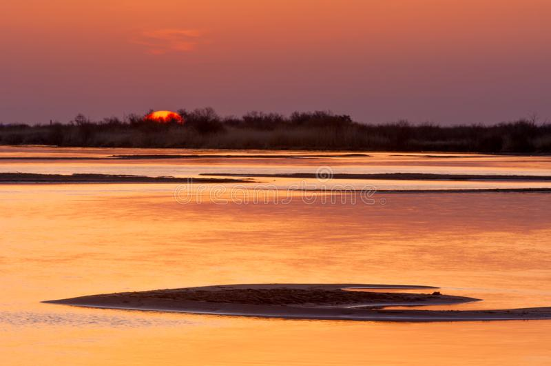 Sunrise sunset. Sunrise over the river. golden waves in the rays of the rising sun royalty free stock images