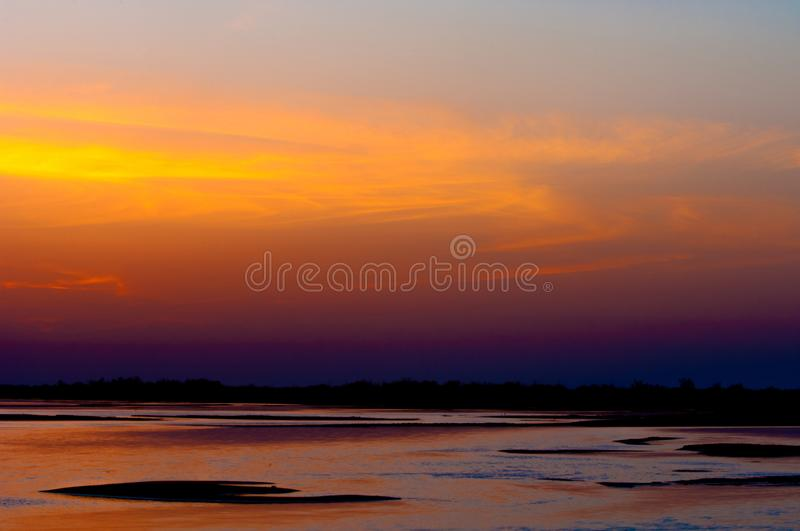 Sunrise sunset. Sunrise over the river. golden waves in the rays of the rising sun stock photography