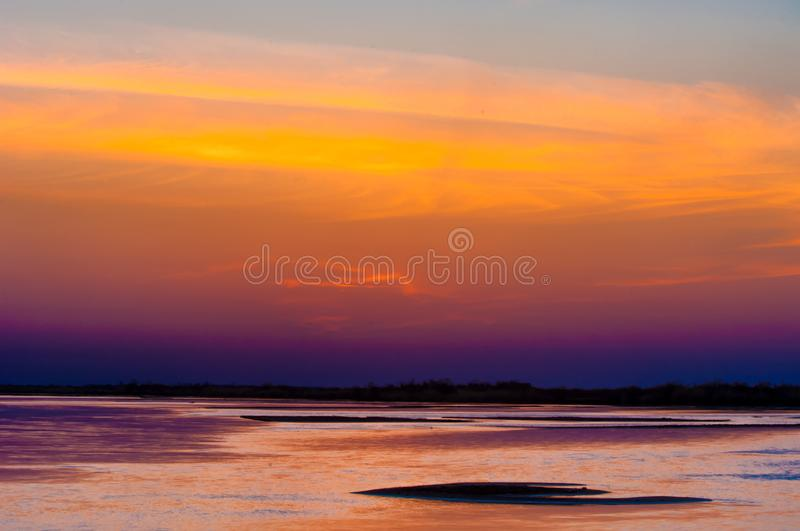 Sunrise sunset. Sunrise over the river. golden waves in the rays of the rising sun stock images