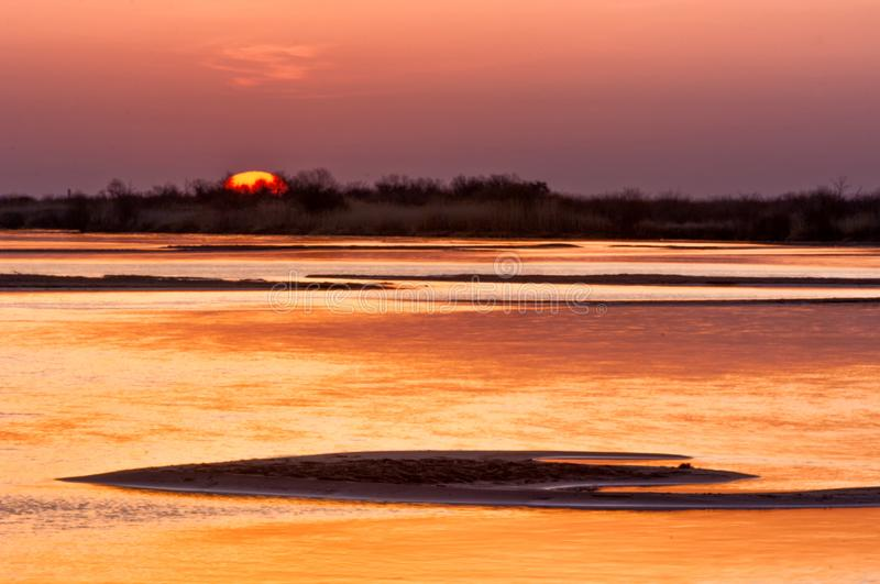 Sunrise sunset. Sunrise over the river. golden waves in the rays of the rising sun royalty free stock photo
