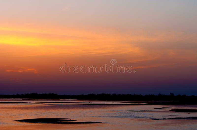 Sunrise sunset. Sunrise over the river. golden waves in the rays of the rising sun royalty free stock photos