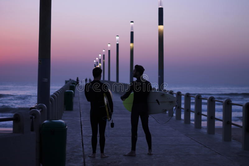 Sunrise surfing stock images