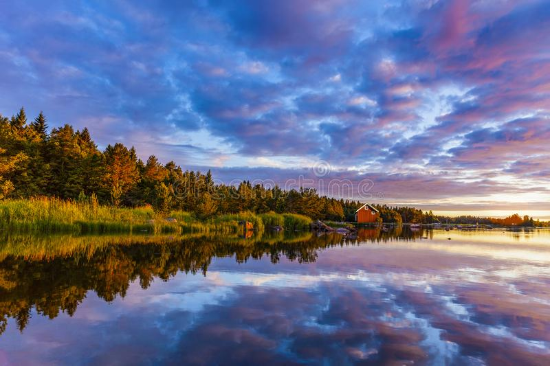 Sunrise on a Swedish lake in summertime stock images