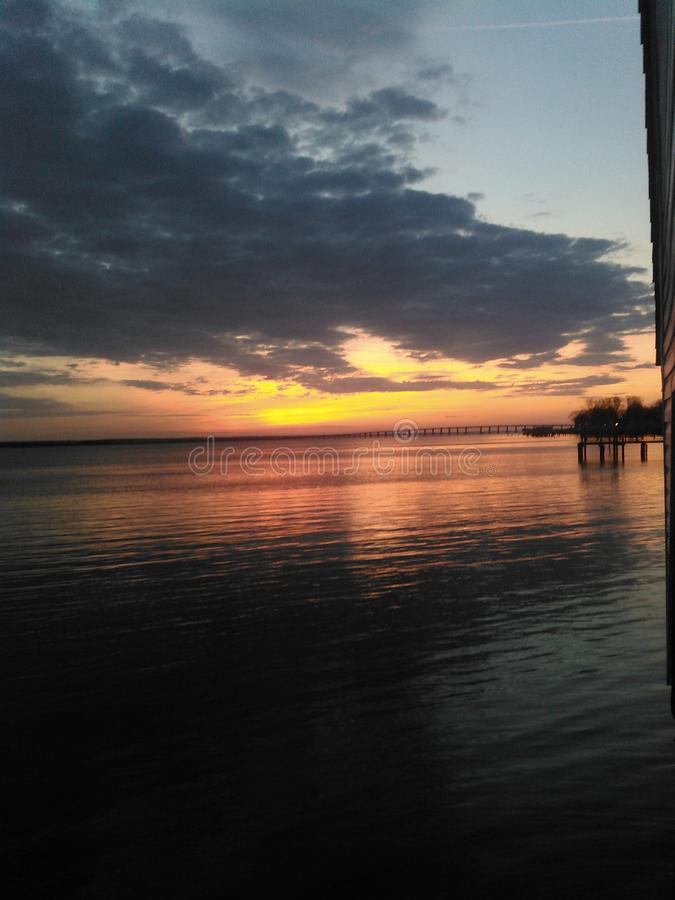 Sunrise in tappahannock, va. Colorful sunrise, start of a blessed day on the chesapeake bay. Start your day here, then go crabbing in kilmarnock stock images