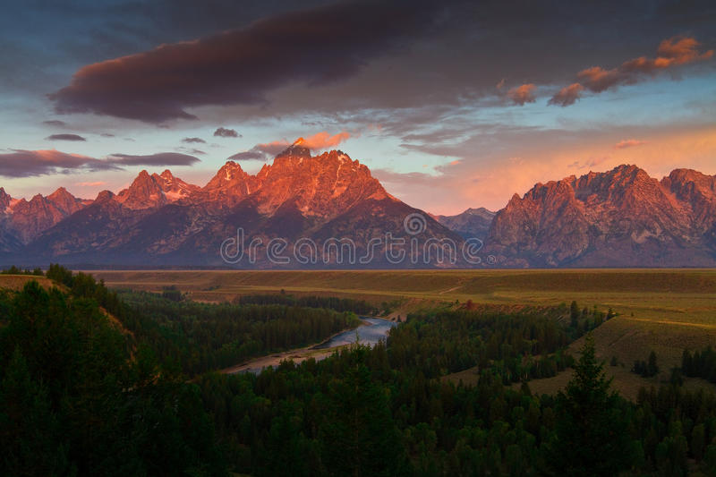 Sunrise of The Tetons tower over the Snake river royalty free stock photography