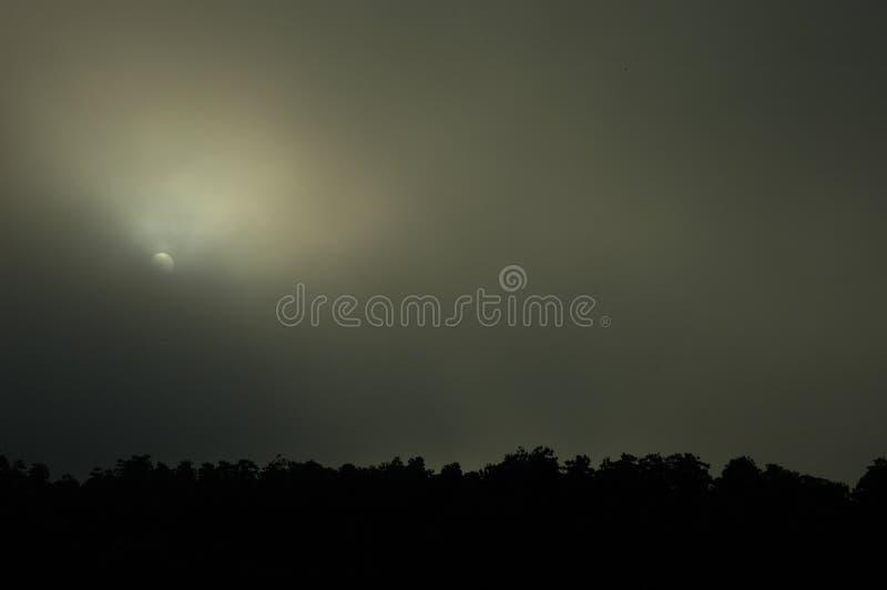 Sunrise in Thick Fog, Krabi Town, Thailand royalty free stock photos