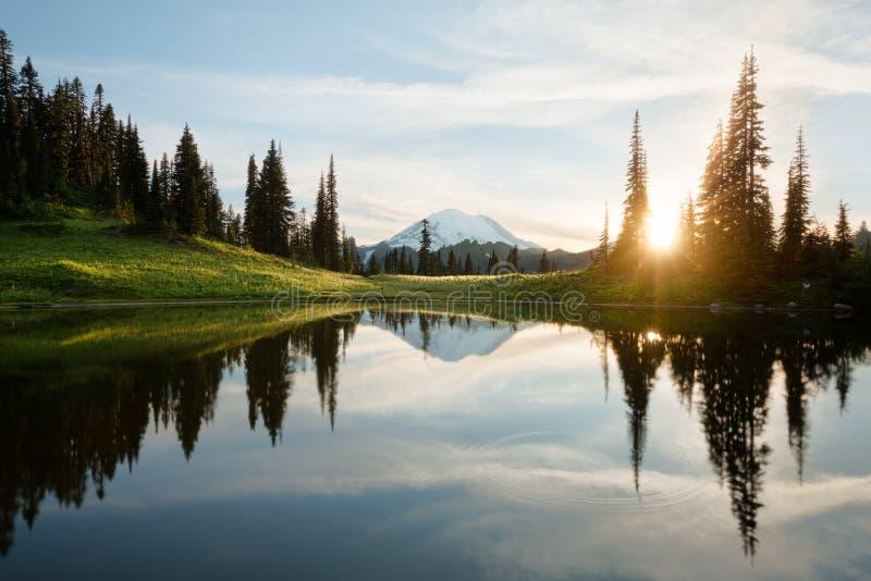 Sunrise at Tipsoo Lake with Mt. Rainier stock photo