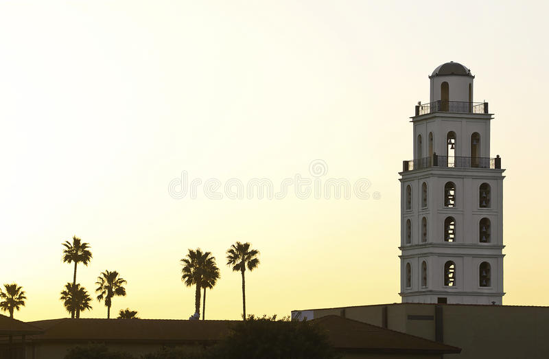Sunrise Tower. Early sunrise is block behind a resort building and its palm trees royalty free stock photos
