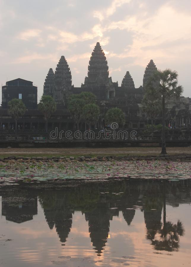 A sunrise with UNESCO Angkor Wat Temple reflection near Siem Reap in Cambodia royalty free stock images