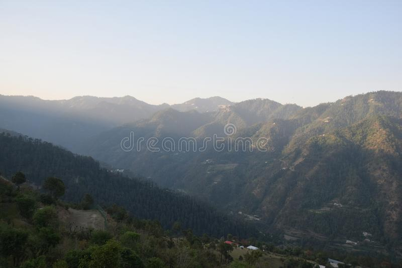 Dawn in the valleys of himachal. Sunrise in the valleys of himalayas stock photo