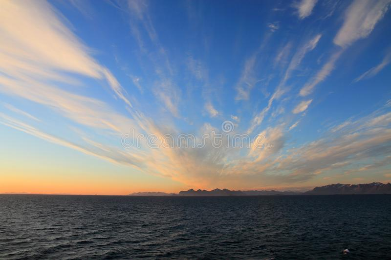 Midnight sun on the vestfiord with Lofoten mountains. Midnight sun seen from Vestfiorden, the mountains of Lofoten islands on the background , Norway, region of royalty free stock photos