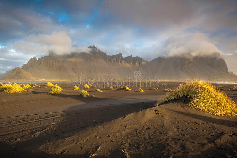 Sunrise At Vestrahorn. Gorgeous morning sunlight at the beach in Stokksnes in Iceland with Mighty Vestrahorn shrouded in cloud stock images