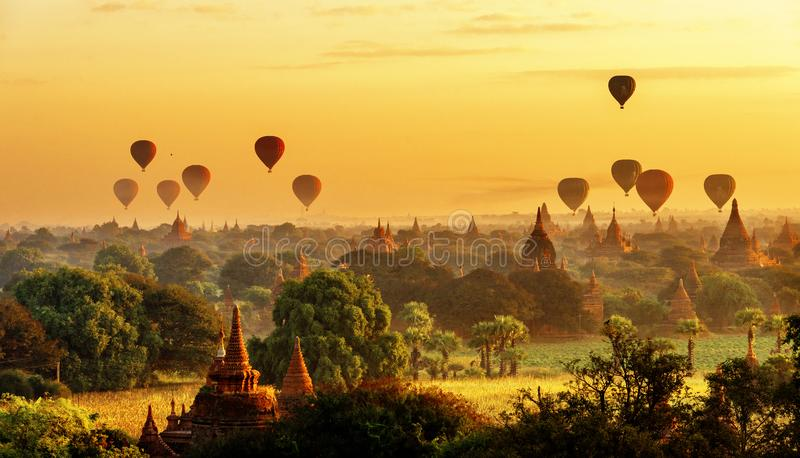 Sunrise view of beautiful pagodas and hot air balloons, Myanmar stock photo