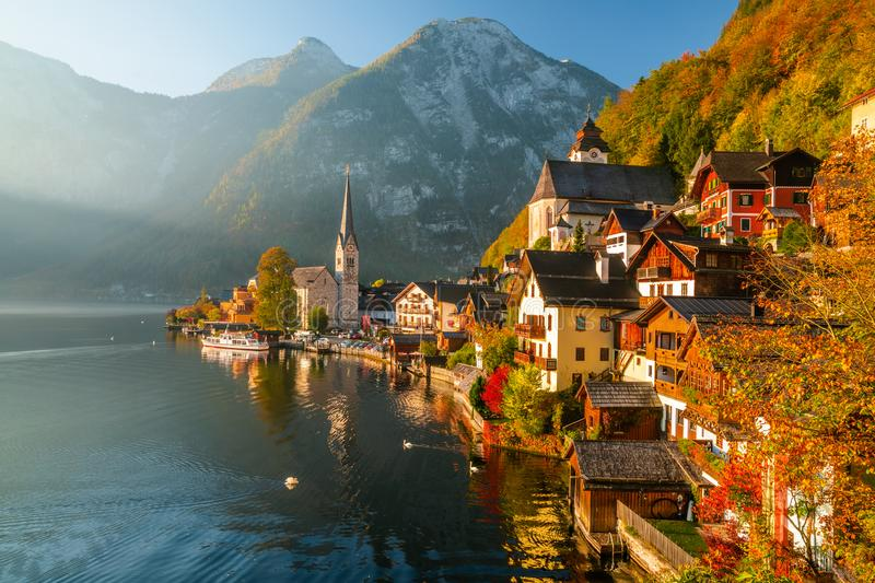 Sunrise view of famous Hallstatt mountain village with Hallstatter lake, Austria.  royalty free stock photography
