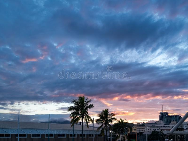 Sunrise View from the Ferry Terminal in Noumea Port, New Caledonia. Sunrise City View -with fog lifting from mountains in the distance- from the Ferry Terminal stock photos