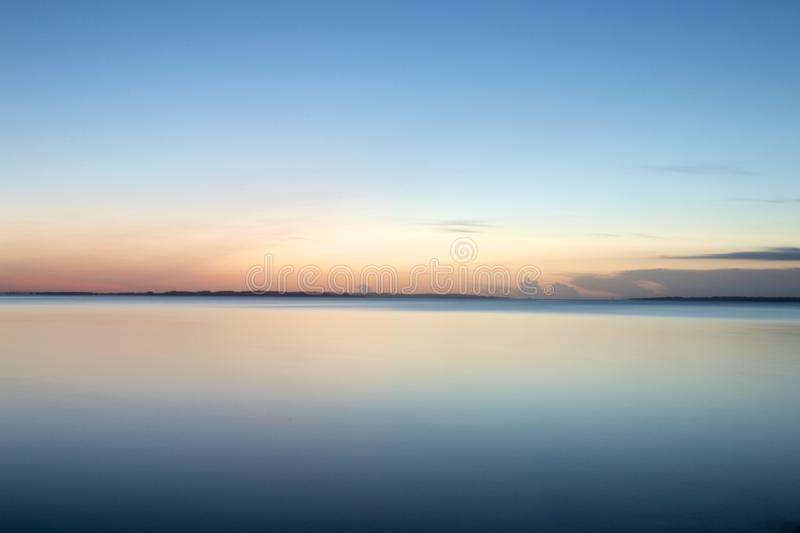 Sunrise. A view from Moesgaard beach, Denmark. Early morning long exposure stock images
