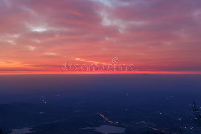 Sunrise view of mount tai. The morning glow of sunrise.Clouds surge, colorful clouds at sunrise.The sunrise on the horizon. This is the scene taken at the top stock photo