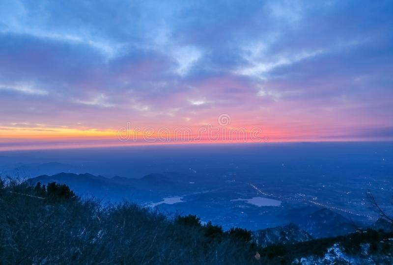 Sunrise view of mount tai. The morning glow of sunrise.Clouds surge, colorful clouds at sunrise.The sunrise on the horizon. This is the scene taken at the top royalty free stock photo