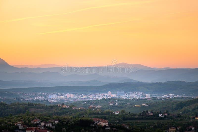Sunrise view over wine region Brda to town Nova Gorica. View over vineyards in wine region Brda on sunrise to town Nova Gorica with Julian Alps and Triglav stock photos
