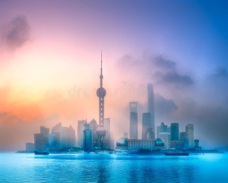 Sunrise view of Shanghai skyline with sunshine. Sunrise scenery view of Shanghai skyline and Huangpu river with reflection of sun on buildings, China stock images