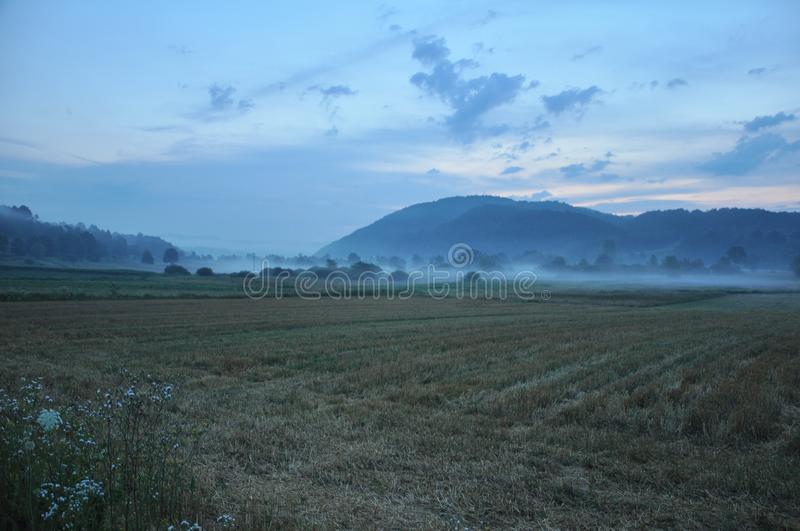 Sunrise village idyll,dying,Landscape, dawning dawn in the countryside. Fog, morning mist, rolling in the mist stock photos