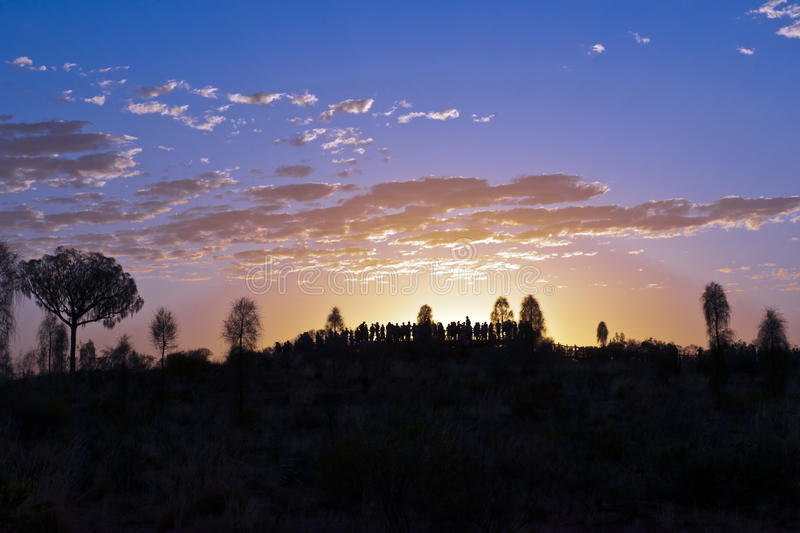 Sunrise watching on Ayers Rock. People are watching the spectacular sunrise at Ayers Rock royalty free stock photos