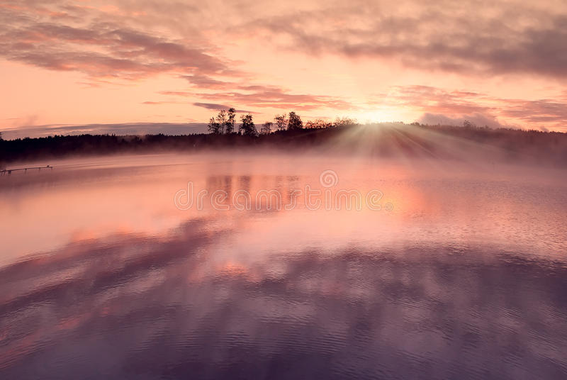 Sunrise water clouds royalty free stock photography