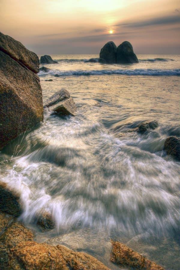 Sunrise with wave splash seashore. Photo of wave splash at a seashore with sunrise on background royalty free stock images