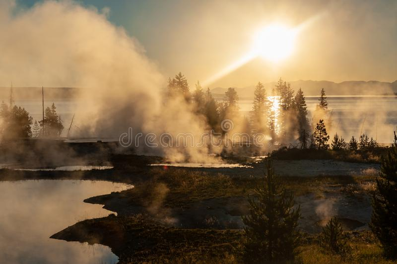 Sunrise the the West Thumb Aera of Yellowstone National Park. Early morning impression of the West Thumb Area in Yellowstone National Park stock images