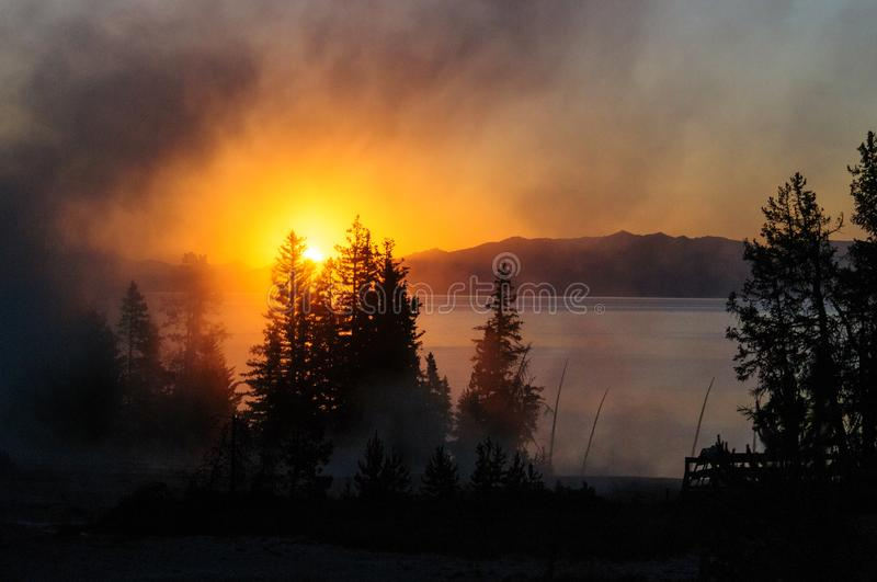 Sunrise in West Thumb. A sunrise in the West Thumb Area in Yellowstone National Park stock photography