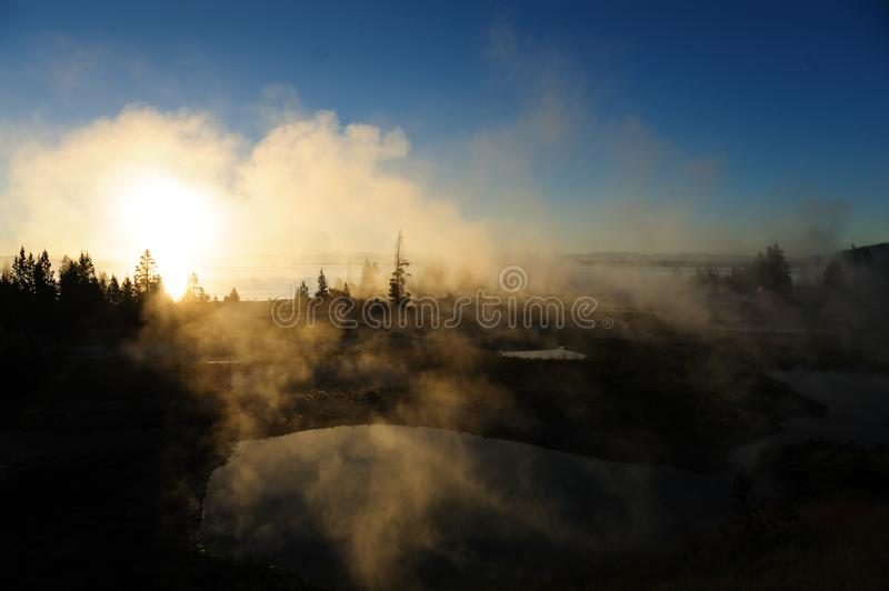 Sunrise in West Thumb. A sunrise in the West Thumb Area in Yellowstone National Park royalty free stock image