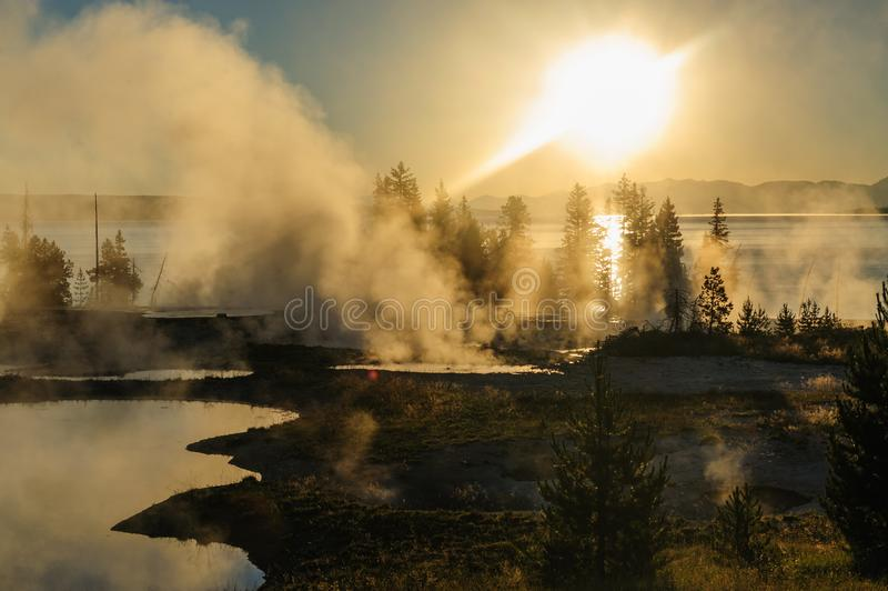 Sunrise in West Thumb. A sunrise in the West Thumb Area in Yellowstone National Park stock photo
