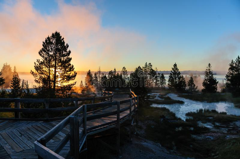 Sunrise in West Thumb. A sunrise in the West Thumb Area in Yellowstone National Park, illuminating the boardwalks royalty free stock photos