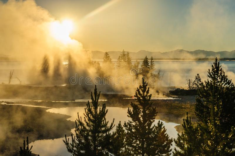 Sunrise in West Thumb. A sunrise in the West Thumb Area in Yellowstone National Park stock images