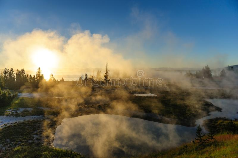 Sunrise in West Thumb. A sunrise in the West Thumb Area in Yellowstone National Park stock image