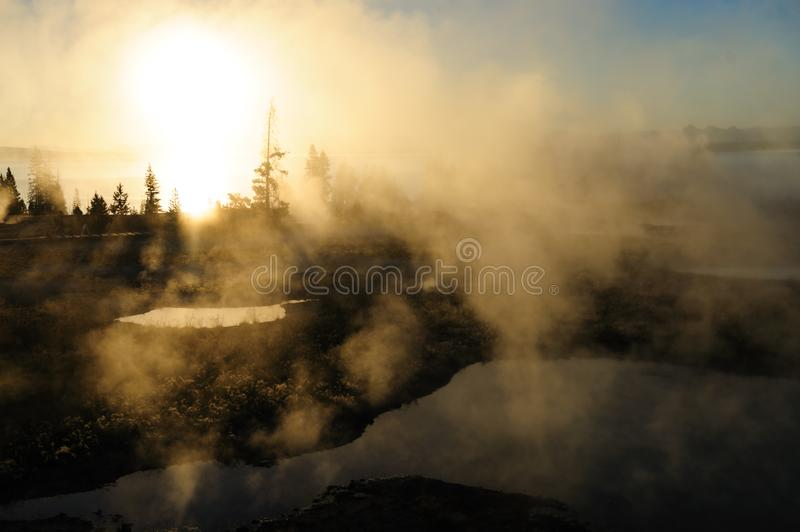 Sunrise in West Thumb. A sunrise in the West Thumb Area in Yellowstone National Park royalty free stock images