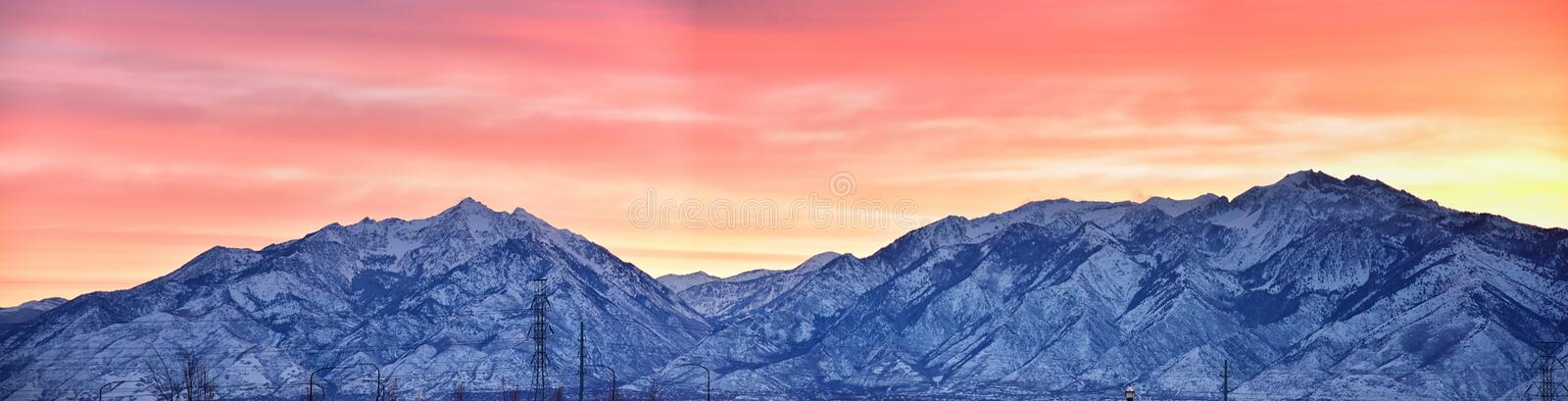 Sunrise of Winter panoramic, view of Snow capped Wasatch Front Rocky Mountains, Great Salt Lake Valley and Cloudscape from the Mou stock images