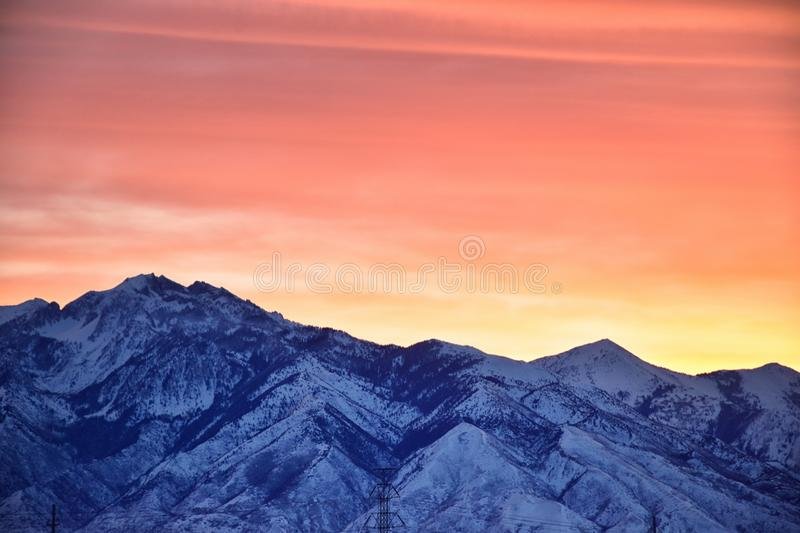 Sunrise of Winter panoramic, view of Snow capped Wasatch Front Rocky Mountains, Great Salt Lake Valley and Cloudscape from the Mou stock photos