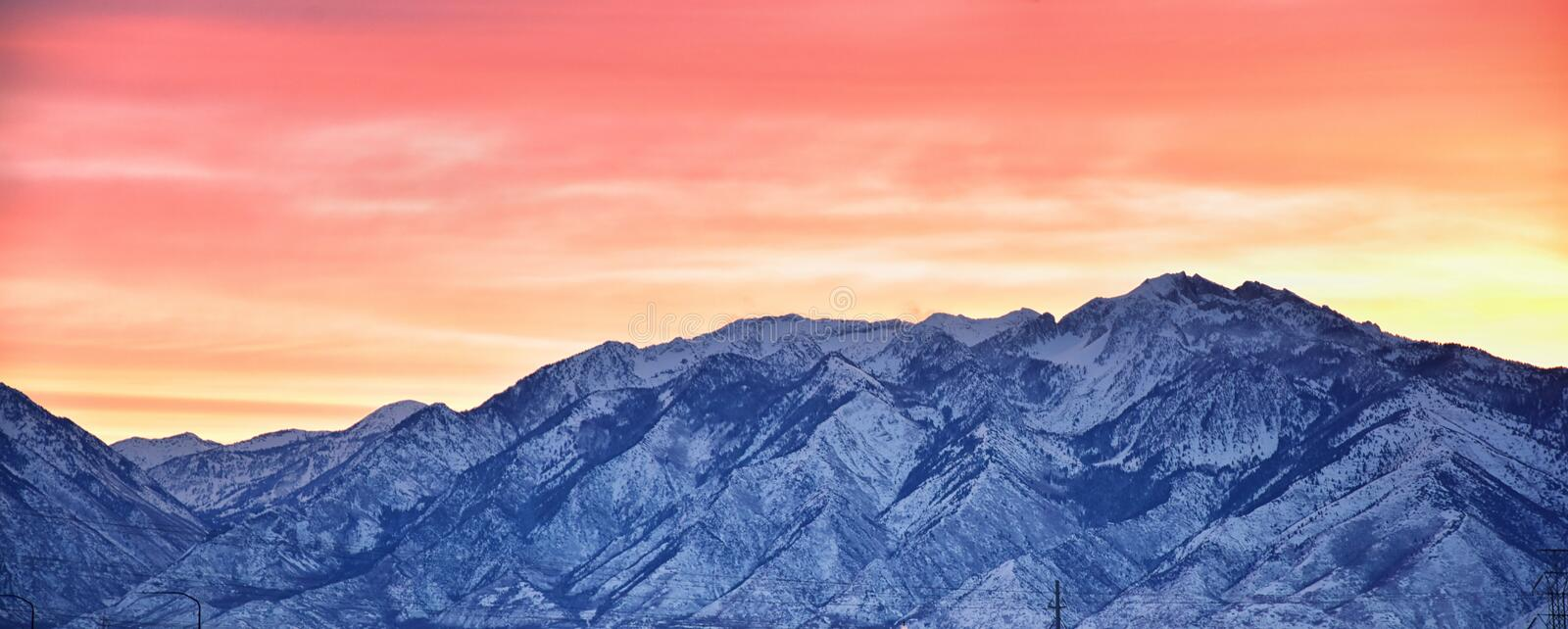 Sunrise of Winter panoramic, view of Snow capped Wasatch Front Rocky Mountains, Great Salt Lake Valley and Cloudscape from the Mou. Ntain view Corridor Highway royalty free stock photo