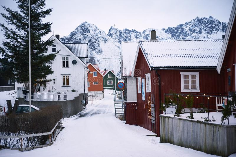 Sunrise, winter, Scandinavian houses, snow-capped mountains, stock photos