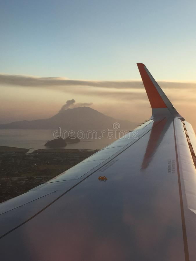 Free Sunrise With Erupting Mount Sakurajima From The Plane Royalty Free Stock Image - 96257466
