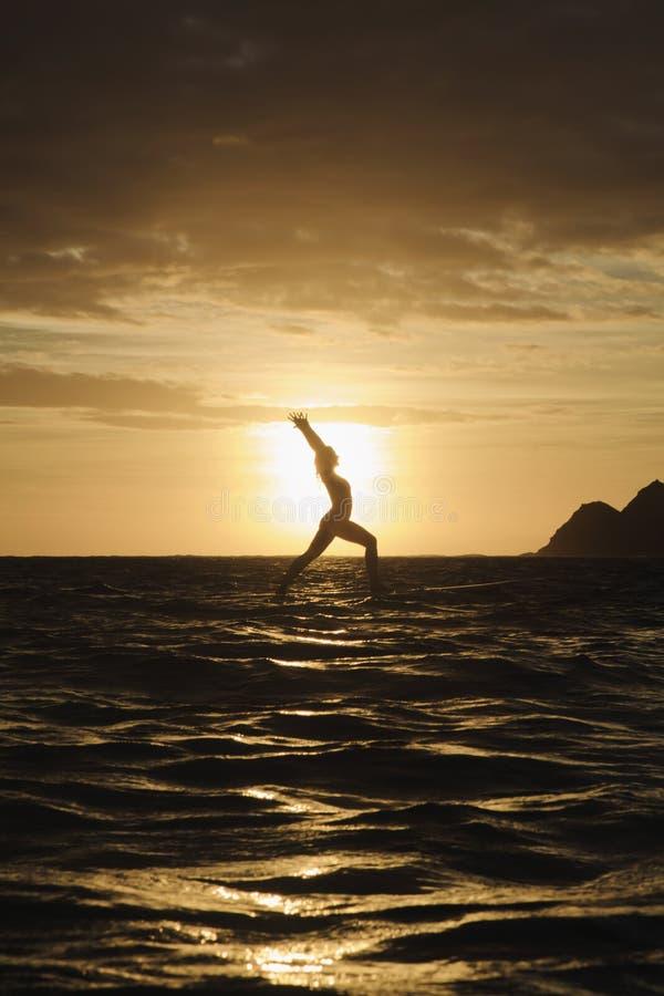 Sunrise Yoga On Paddle Board Stock Images