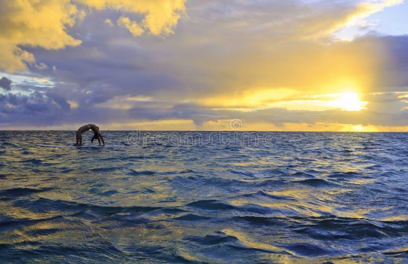 Download Sunrise Yoga On Paddle Board Stock Photo - Image: 26601026