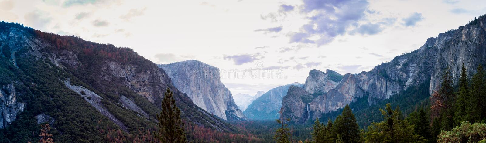 Sunrise at Yosemite Valley vista point. Panorama of Yosemite Valley from Valley View vista point, including Half Dome and Bridal Veil Falls royalty free stock image