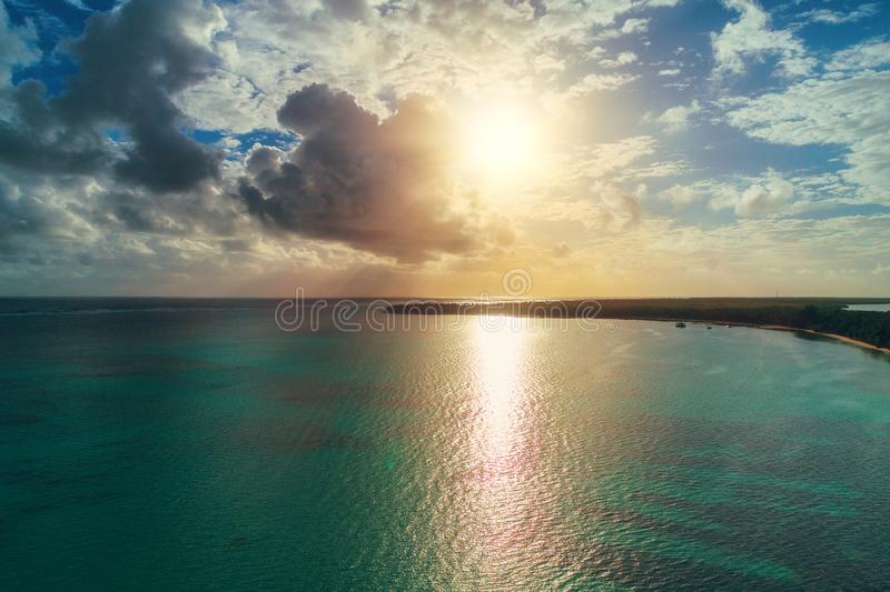 Sunriseover carribean sea and tropical island. Aerial view of Pu royalty free stock photo