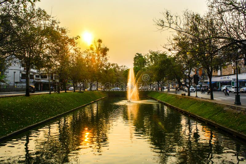 Sunrises behine lake in city royalty free stock photos